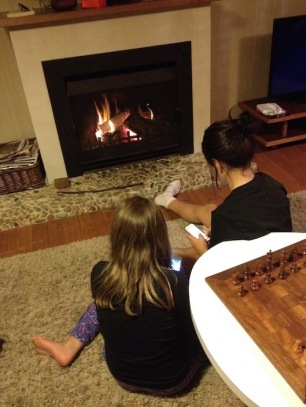 Kids by the fireplace.